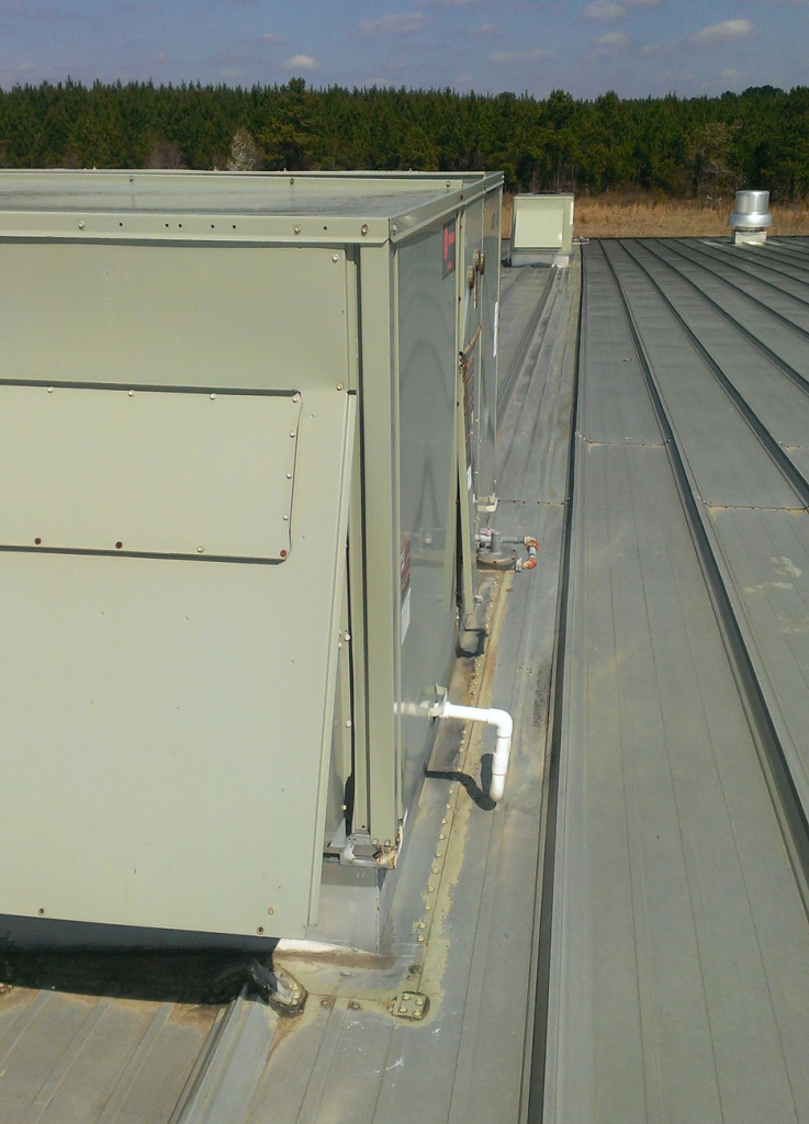 Leaky Roof-Mounted AC Unit on This Commercial Metal Roof