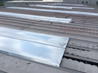 Commercial Roofing Photos - Weird Metal Pan Covers on Low-Slope Commercial Metal Roof