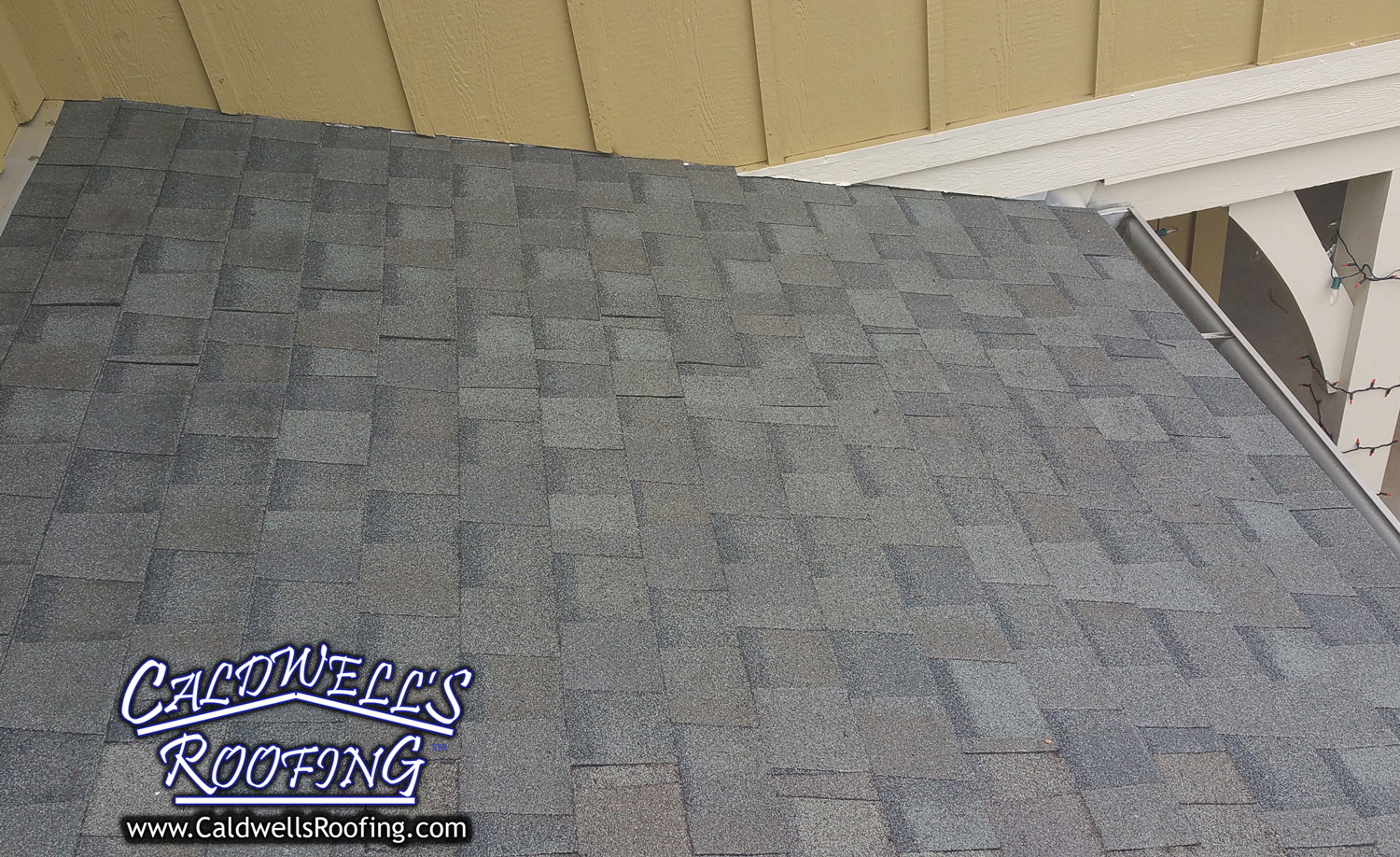 Wrapping Up the Roof Repair with New Shingles, Carefully Matched to the Brand and Color of the Previous Shingles