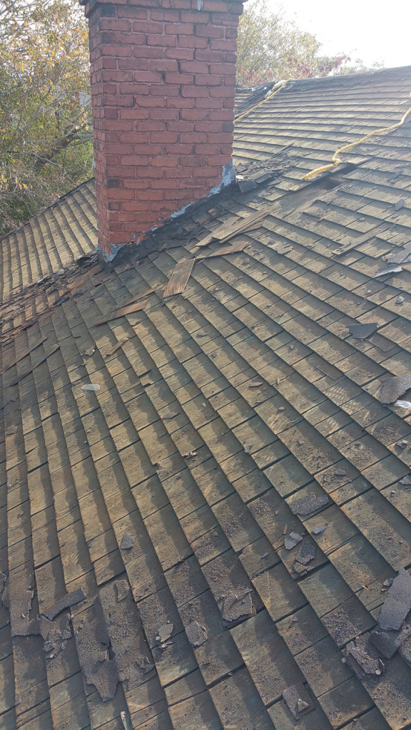 Seven Layers of Shingles Having Been Removed, Only the Old Wood Shakes Remain